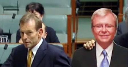 Liberal MP Tony Abbott stands alongside a cardboard cutout of Australian Prime Minister Kevin Rudd